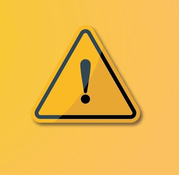 Grafika o żółtym tle przedstawiająca żółty znak ostrzegawczy z czarnym wykrzyknikiem.